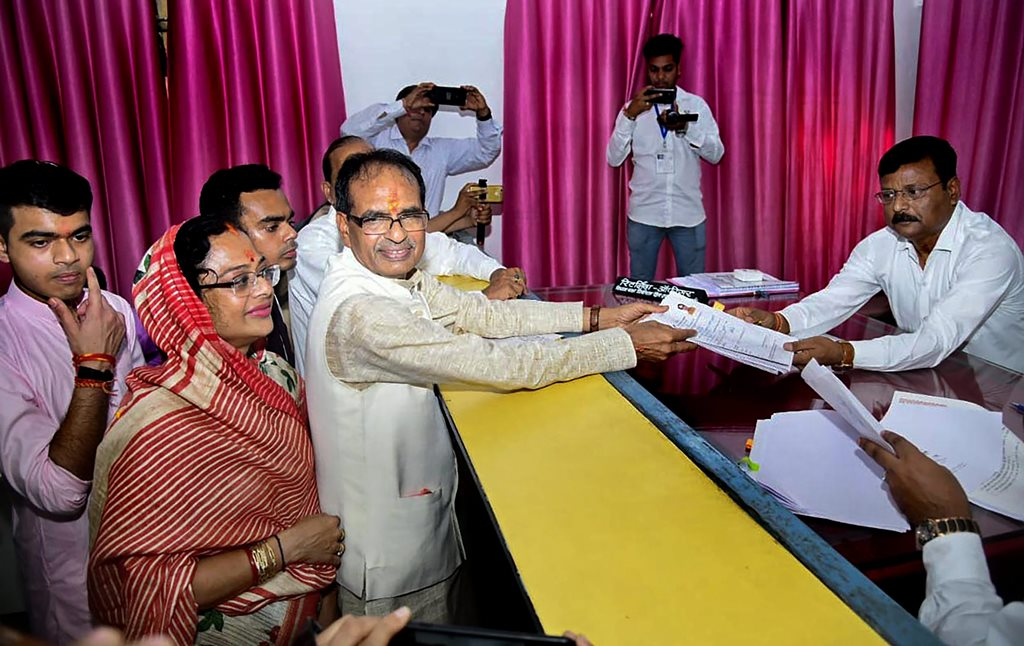 Sehore: Madhya Pradesh Chief Minister and BJP candidate Shivraj Singh Chouhan files his nomination paper in view of upcoming Assembly Elections, from Budhni, Sehore district, Monday, Nov 05, 2018. Shivraj's wife Sadhna and sons Kunal and Kartikey are also seen. (PTI Photo)(PTI11_5_2018_000085B)