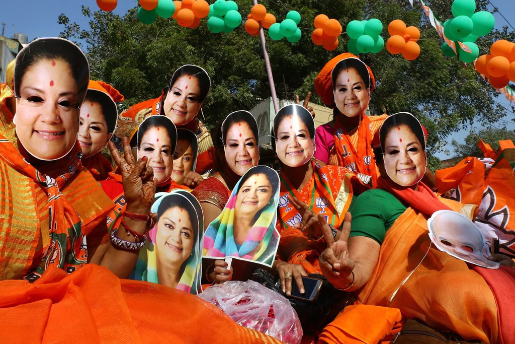Ajmer: Bharatiya Janata Party (BJP) supporters wear masks of Rajasthan Chief Minister Vasundhara Raje at an election rally, in Ajmer, Wednesday, Dec. 05, 2018. (PTI Photo)(PTI12_5_2018_000049B)