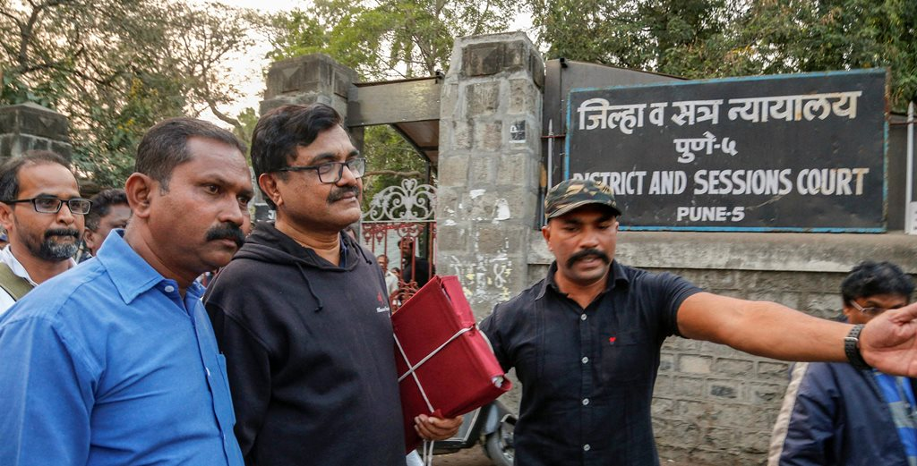 Pune: Activist Anand Teltumbde (black pullover) leaves after Pune District and Sessions Court released him in Bhima Koregaon case, in Pune, February 2, 2019. (PTI Photo) (PTI2_2_2019_000195B)