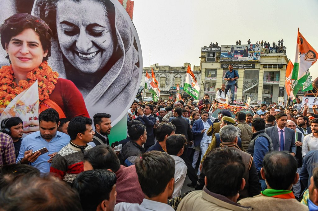 Lucknow: A hoarding with the picture of Congress General Secretary Priyanka Gandhi Vadra along with her grandmother, former prime minister Indira Gandhi during her roadshow in Lucknow, Monday, Feb. 11, 2019. (PTI Photo/Atul Yadav) (PTI2_11_2019_000229B)