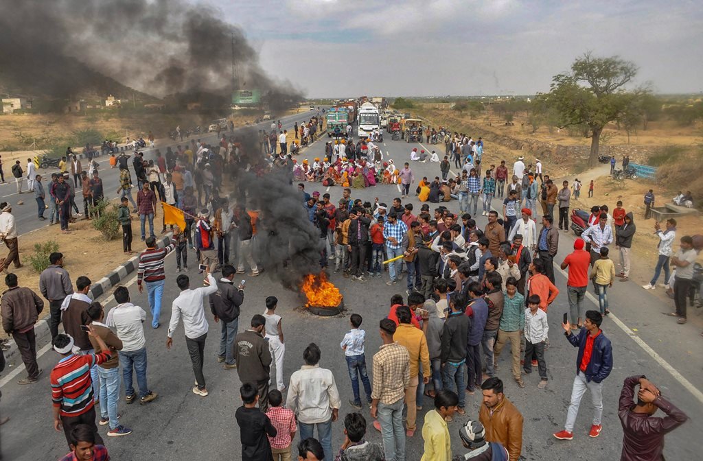 Ajmer: Gujjar community members block national highway 58 in support of their demand for reservation in Ajmer, Sunday, Feb 10, 2019. (PTI Photo) (PTI2_10_2019_000159B)
