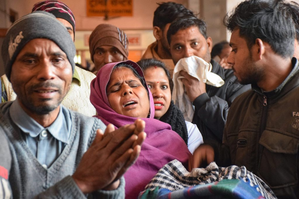 Saharnapur: Family members of victims who are undergoing treatment on being poisoned after consuming a spurious liquor, at a hospital in Saharanpur, Saturday, Feb 9, 2019. The death toll in the hooch tragedy that hit two adjoining districts in Uttarakhand and Uttar Pradesh has risen to 70 with more people dying of the spurious liquor. (PTI Photo) (PTI2_9_2019_000099B)