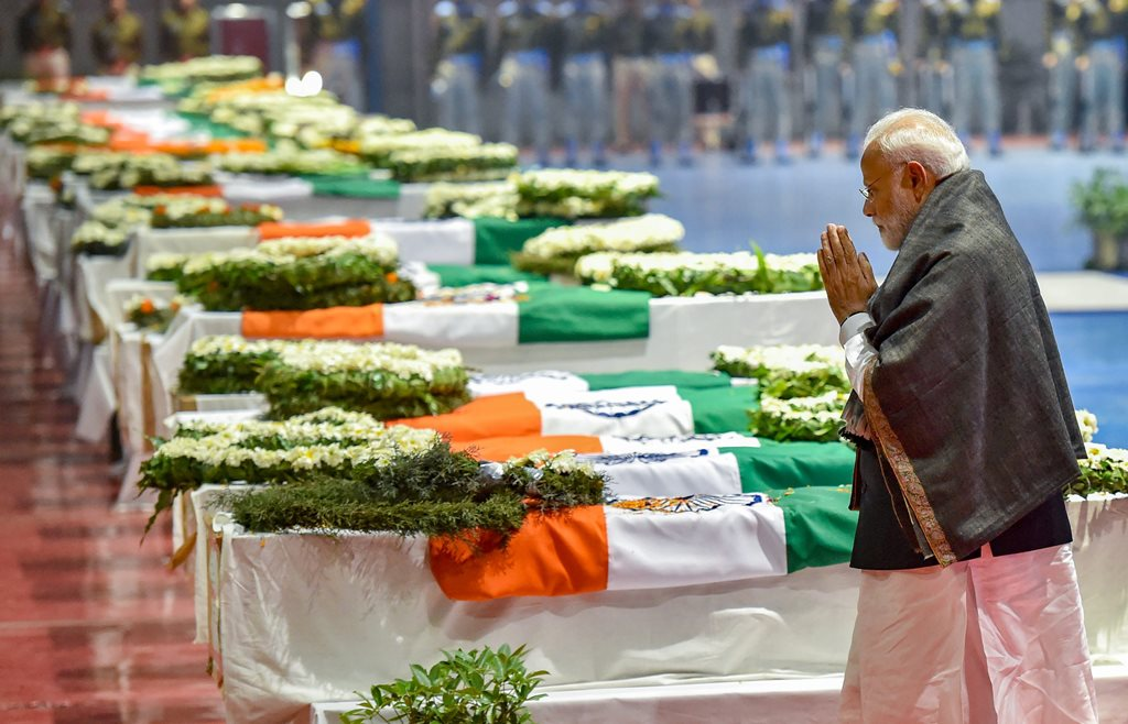 New Delhi: Prime Minister Narendra Modi pays tribute to the martyred CRPF jawans, who lost their lives in Thursday's Pulwama terror attack, after their mortal remains were brought at AFS Palam in New Delhi, Friday, Feb 15, 2019. (PTI Photo/Manvender Vashist) (PTI2_15_2019_000235B)