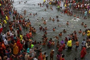 """Hindu devotees pray while standing in the Godavari river during """"Kumbh Mela"""" or the Pitcher Festival in Nashik, India, August 28, 2015. Hundreds of thousands of Hindus took part in the religious gathering at the banks of the Godavari river in Nashik city at the festival, which is held every 12 years in different Indian cities. REUTERS/Danish Siddiqui"""