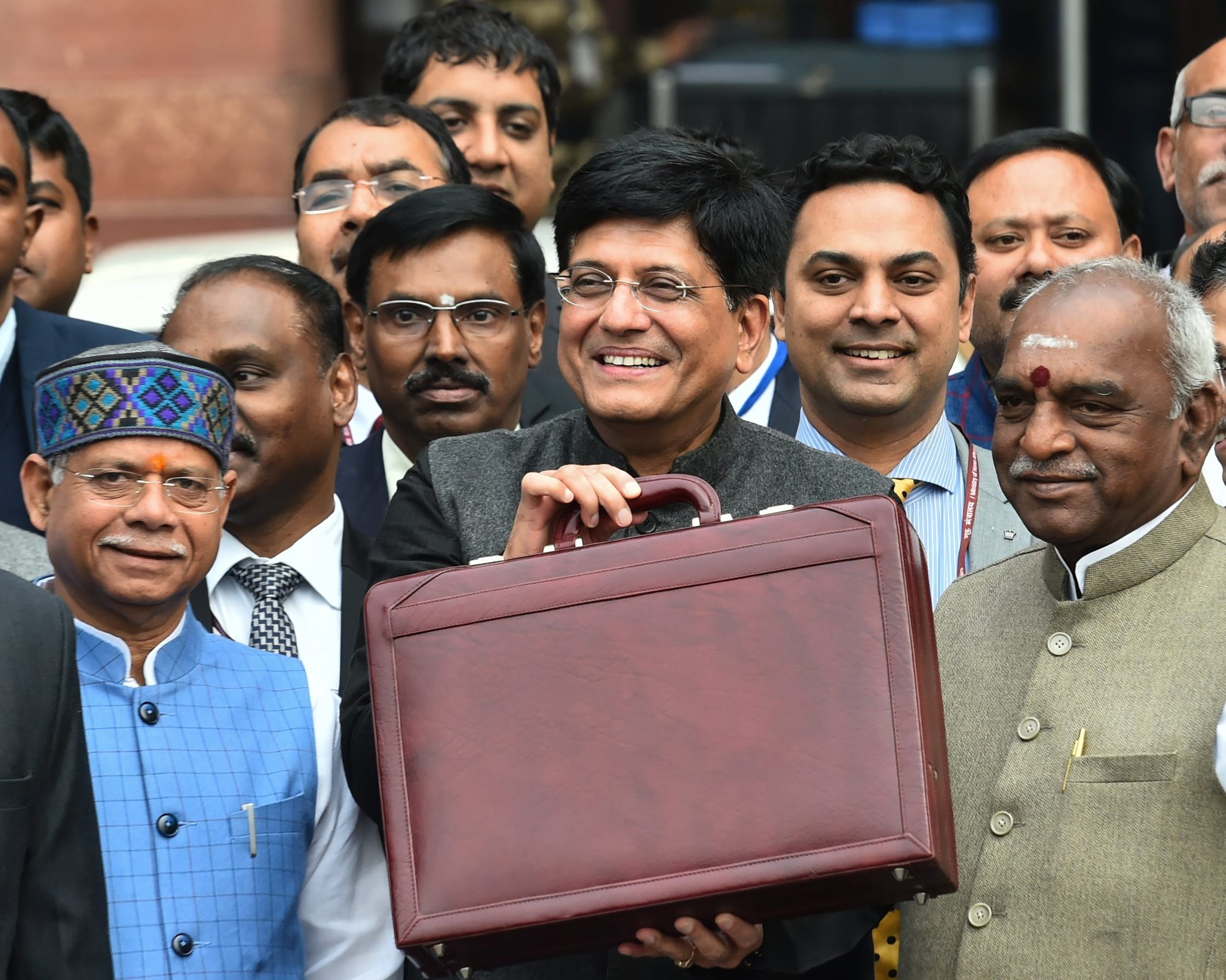 New Delhi: Finance Minister Piyush Goyal with MoS Finance ministers Shiv Pratap Shukla and P Radhakrishnan leaves the North Block to present the interim Budget 2019-20 at Parliament, in New Delhi, Friday, 1 Feb, 2019. (PTI Photo/ Arun Sharma)(PTI2_1_2019_000011B)
