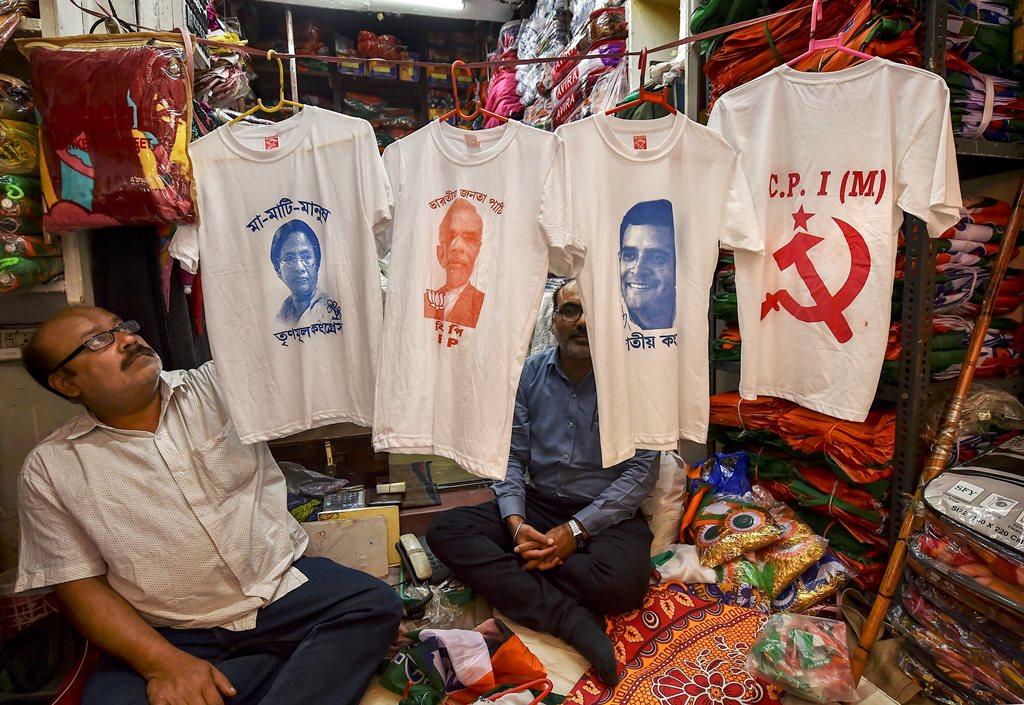 Kolkata: A shopkeeper displays T-shirts with portraits of politicians printed on them, ahead of the Lok Sabha polls, in Kolkata, Thursday, March 14, 2019. (PTI Photo/Swapan Mahapatra)(PTI3_14_2019_000108B)