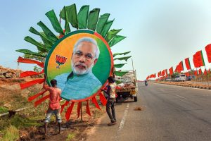 Kanyakumari: Workers place a huge portrait of Prime Minister Narendra Modi along a road ahead of his rally, in Kanyakumari, Thursday, Feb. 28, 2019. (PTI Photo)(PTI2_28_2019_000137B)