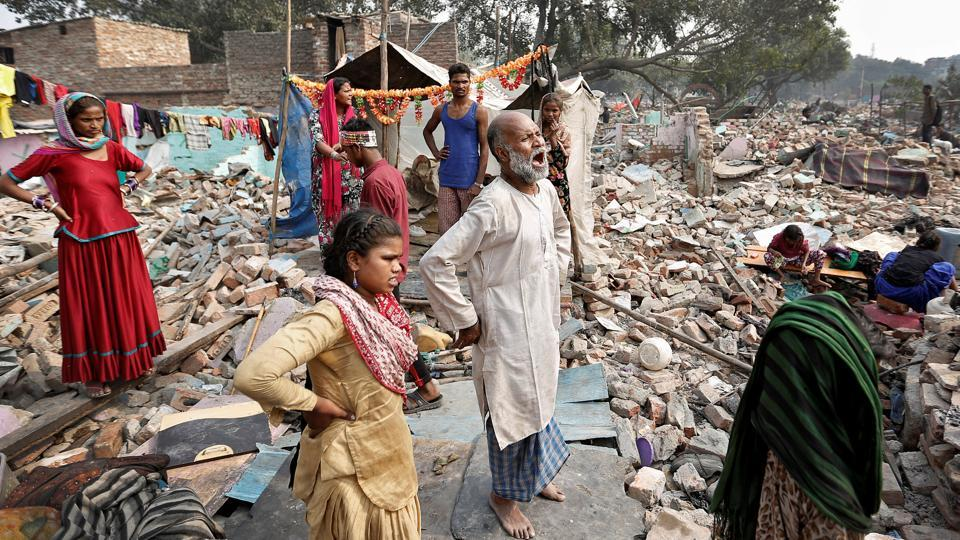 A man reacts amid the rubble of his home in a slum which was razed by authorities in Delhi. (REUTERS File Photo)