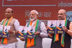New Delhi: Prime Minister Narendra Modi, BJP President Amit Shah and Union Home Minister Rajnath Singh release Bharatiya Janata Party's (BJP) manifesto (Sankalp Patra) for Lok Sabha elections 2019, in New Delhi, Monday, April 08, 2019. (PTI Photo/Atul Yadav)(PTI4_8_2019_000046B)