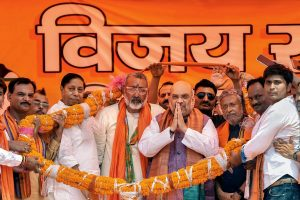 Begusarai: BJP President Amit Shah being garlanded by the party workers during an election campaign rally ahead of the Lok Sabha polls, in Begusarai district, Wednesday, April 24, 2019. (PTI Photo) (PTI4_24_2019_000051B)