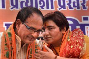 Bhopal: BJP candidate for Bhopal Lok Sabha constituency Sadhvi Pragya Singh Thakur with BJP National Vice President Shivraj Singh Chouhan before filing her nomination papers for Lok Sabha polls, in Bhopal, Tuesday, April 23, 2019. (PTI Photo) (PTI4_23_2019_000154B)