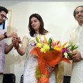 Mumbai: Yuva Sena chief Aditya Thackeray (L) and Shiv Sena Chief Uddhav Thackeray (R) welcome Priyanka Cahturvedi into the party by tying 'Shiv Bandhan', at Matoshri in Mumbai, Friday, April 19, 2019. (PTI Photo) (PTI4_19_2019_000074B)