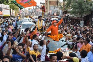Gorakhpur: BJP candidate from Gorakhpur constituency Ravi Kishan raises slogans at his roadshow for Lok Sabha polls, in Gorakhpur, Thursday, April 18, 2019. (PTI Photo) (PTI4_18_2019_000264B)