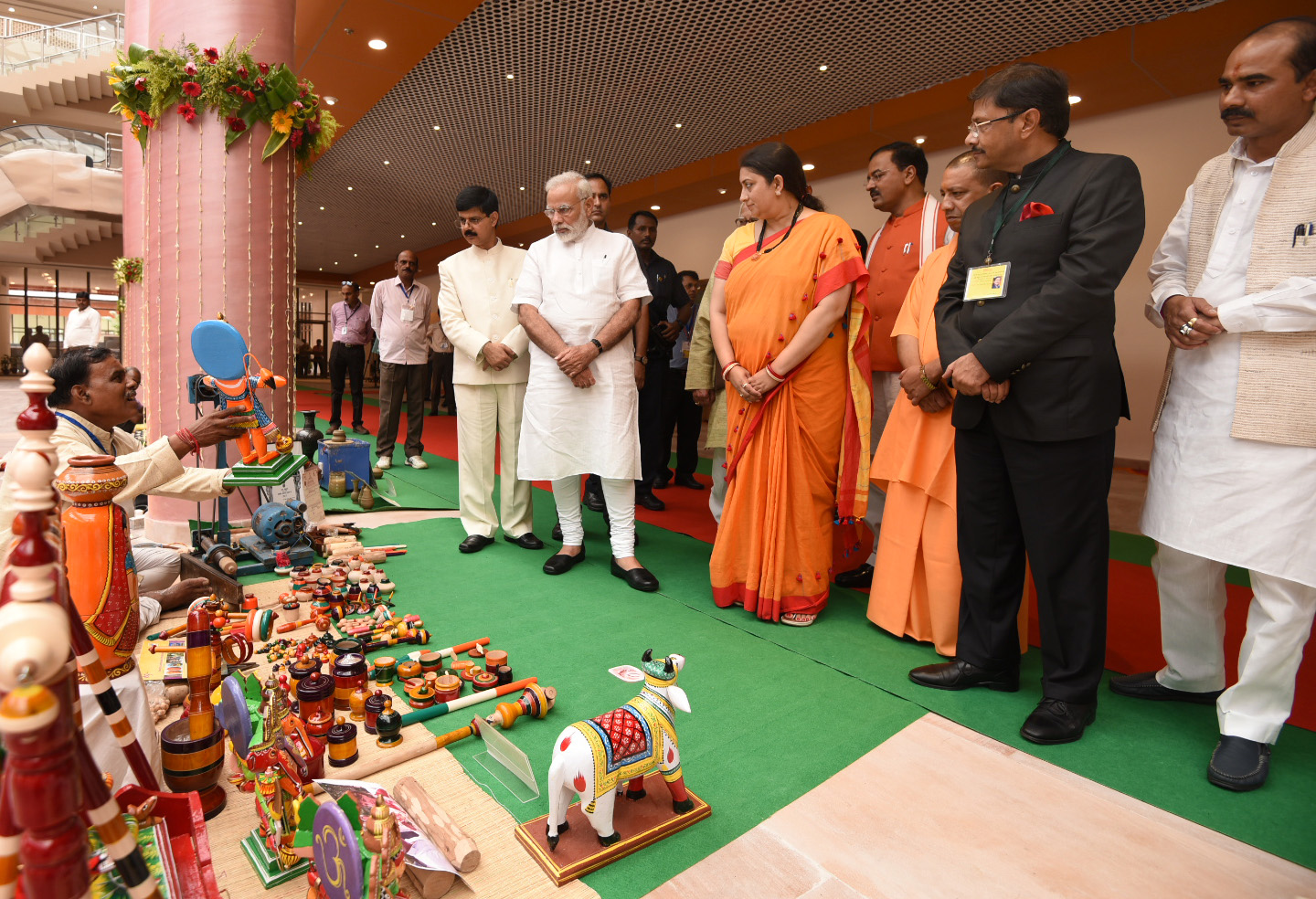 The Prime Minister, Shri Narendra Modi meets the artisans and weavers, at the Deendayal Hastkala Sankul, Varanasi, Uttar Pradesh on September 22, 2017. The Union Minister for Textiles and Information & Broadcasting, Smt. Smriti Irani, the Chief Minister, Uttar Pradesh, Yogi Adityanath, the Minister of State for Textiles, Shri Ajay Tamta and the Deputy Chief Minister, Uttar Pradesh, Shri Keshav Prasad Maurya are also seen.