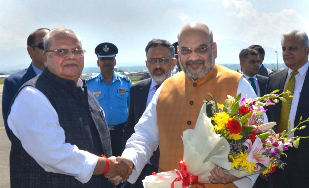 Srinagar: Union Home Minister Amit Shah being received by Jammu and Kashmir Governor Satya Pal Malik on his arrival at the airport in Srinagar, Wednesday, June 26, 2019, for a two-day visit to the Valley to review the security arrangements in the view of Amarnath Yatra. (PTI Photo) (PTI6_26_2019_000124B)