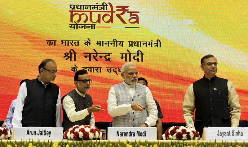 The Prime Minister, Shri Narendra Modi launching the Pradhan Mantri MUDRA Yojana, in New Delhi on April 08, 2015. The Union Minister for Finance, Corporate Affairs and Information & Broadcasting, Shri Arun Jaitley, the Minister of State for Finance, Shri Jayant Sinha and the secretary, Department of Financial Services (DFS), Ministry of Finance, Dr. Hasmukh Adhia are also seen.