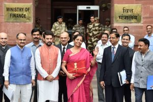 New Delhi: Finance Minister Nirmala Sitharaman with MoS Anurag Thakur and others outside the North Block ahead of the presentation of Union Budget 2019-20 at Parliament, in New Delhi, Friday, July 05, 2019. (PTI Photo/Ravi Choudhary)(PTI7_5_2019_000014B)