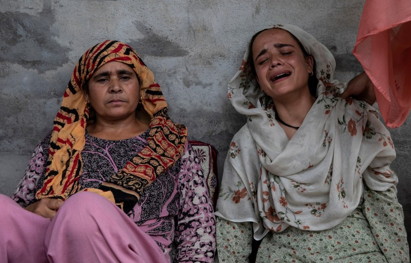 Bilquis, sister of Irfan Ahmad Hurra, who was arrested during a clampdown after the scrapping of the special constitutional status for Kashmir by the government, cries, as their mother Jameela looks on, while they remember Irfan inside their house in Pulwama, south of Srinagar, August 13, 2019. REUTERS/Danish Siddiqui