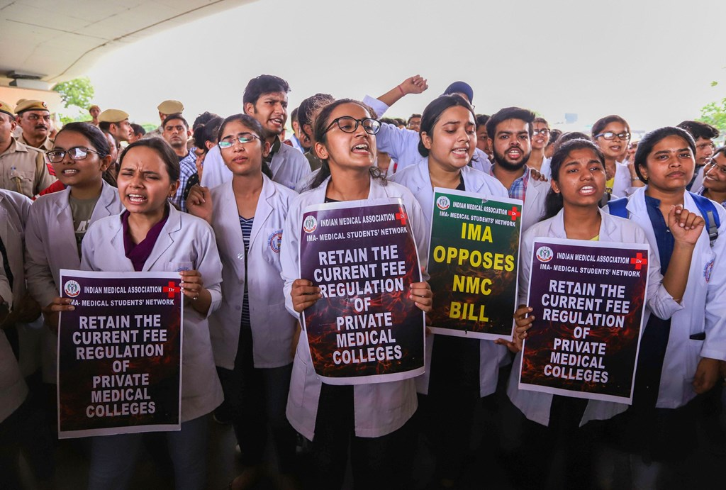 New Delhi: Doctors and medical students of AIIMS display placards during a strike to protest the introduction of the National Medical Commission (NMC) Bill in the Rajya Sabha, in New Delhi, Thursday, Aug 01, 2019. (PTI Photo)(PTI8_1_2019_000129B)