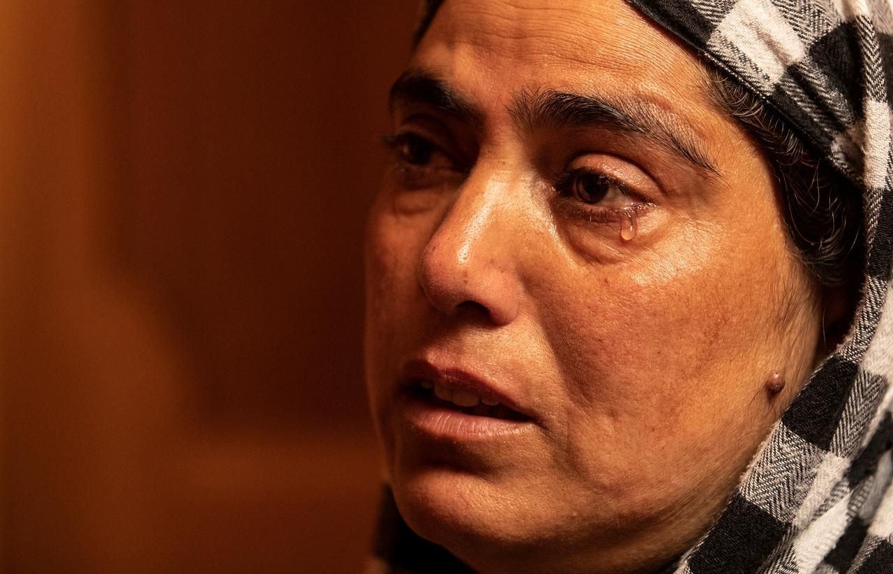 Fareeda, wife of Shameem Ahmad Ganai, who according to Fareeda was arrested during a clampdown a day before the scrapping of the special constitutional status for Kashmir by the government, cries as she remembers him inside her house in Pulwama, south of Srinagar, August 13, 2019. REUTERS/Danish Siddiqui
