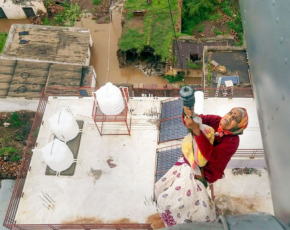 Belgaum: A woman from a flood affected area is rescued by Air Force, in Belgaum district, Thusrday, Aug 8, 2019. (PTI Photo)(PTI8 9 2019 000044B)