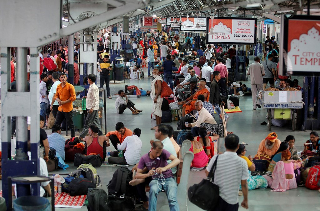 """Jammu: Tourists and passengers wait for their trains as they prepare to leave from Jammu Railway Station, in Jammu, Saturday, Aug 3, 2019. The Jammu and Kashmir government asked the Amarnath pilgrims and tourists on Friday to immediately make necessary arrangements to cut short their stay in the Valley and return as soon as possible in the wake of intelligence inputs of """"specific terror threats"""" to the pilgrimage. (PTI Photo) (PTI8_3_2019_000129B)"""