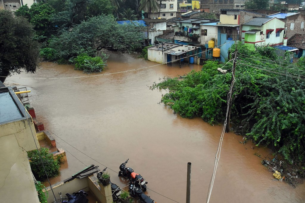 Hubballi: A view of a flood-affected area due to overflow of a water channel following heavy monsoon rain, in Hubballi district, Thursday, Aug 8, 2019. (PTI Photo)(PTI8_8_2019_000051B)