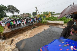 Mysore: Locals stranded as a part of the road collapsed after water from Kabini reservoir in HD Kote was released following heavy monsoon rainfall, in Mysore, Thursday, Aug 8, 2019. (PTI Photo) (PTI8_8_2019_000214B)