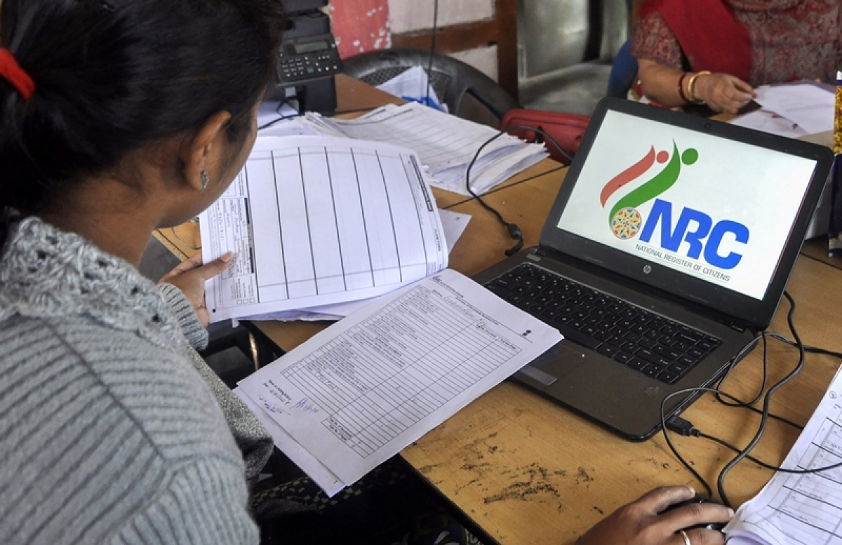 Data entry operators of National Register of Citizens (NRC) carry out correction of names and spellings at an NRC Seva Kendra at Birubari in Guwahati. PTI Photo