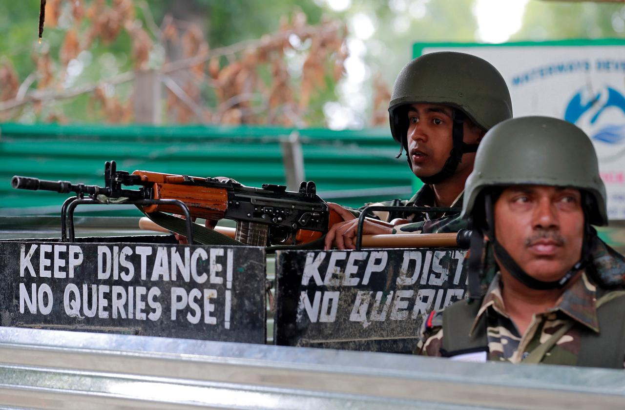 Indian security force personnel keep guard alongside a road during restrictions after the government scrapped the special constitutional status for Kashmir, in Srinagar August 15, 2019. REUTERS/Danish Ismail