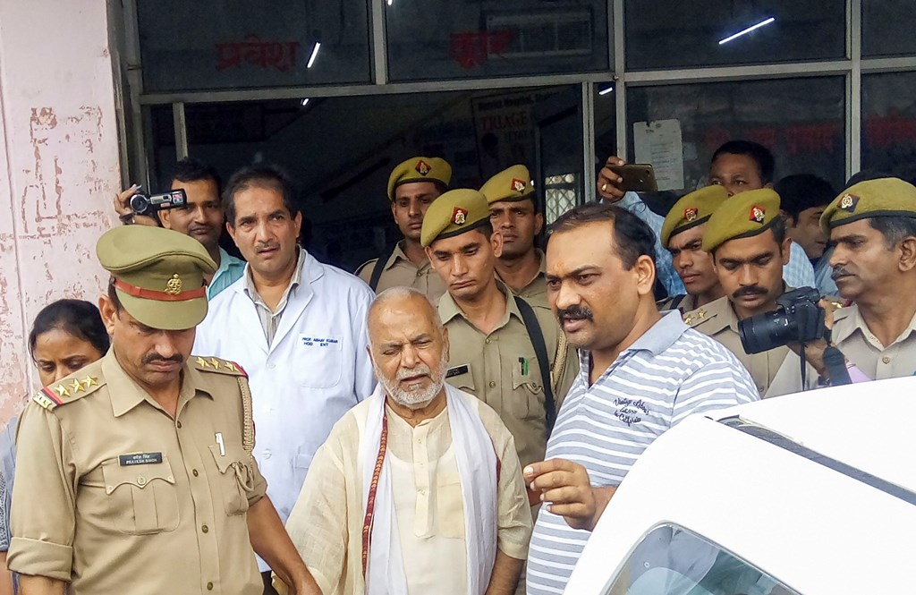 Shahjahanpur: Former Union minister Swami Chinmayanand, accused of rape by a law student, is seen outside a government hospital after a medical examination following his arrest by a special team of Uttar Pradesh police, in Shahjahanpur, Friday, Sept. 20, 2019. (PTI Photo) (PTI9_20_2019_000010B)