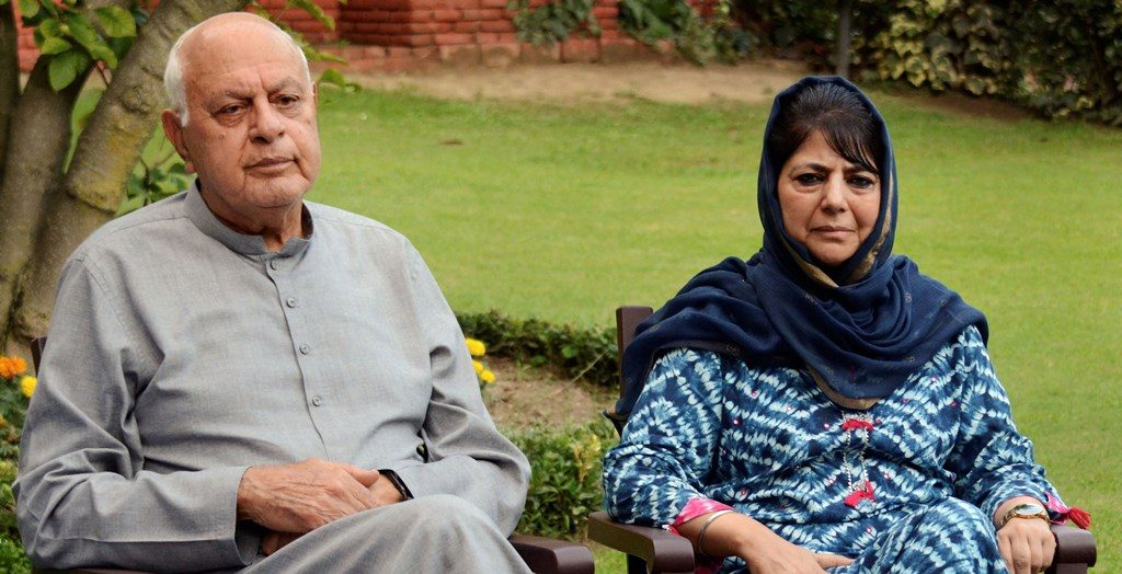 **EDS: FILE PHOTO** Srinagar: In this file photo dated Aug. 4, 2019, are National Conference President Farooq Abdullah and PDP President Mehbooba Mufti during an all party meeting, in Srinagar. The Supreme Court on Monday, Sept. 16, 2019, has sought response from the Centre and the Jammu and Kashmir administration on a plea seeking to produce before court Abdullah, who is allegedly under detention following the scrapping of the state's special status. (PTI Photo) (PTI9_16_2019_000042B)