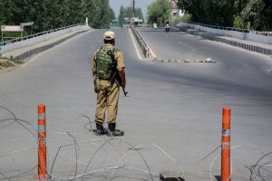 Srinagar: Security personnel stands guard at a blocked road on the 33rd day of strike and restrictions imposed after the abrogration of Article of 370 and bifurcation of state, in Srinagar, Friday, Sept. 6, 2019. (PTI Photo) (PTI9_6_2019_000063A)