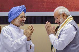 मनमोहन सिंह और नरेंद्र मोदी. (फोटो: पीटीआई)