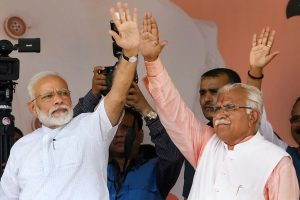 Rohtak: Prime Minister Narendra Modi with Haryana Chief Minister Manohar Lal waves at the crowd during a public rally in Rohtak, Sunday, Sept 8, 2019. (PTI Photo) (PTI9_8_2019_000061B)
