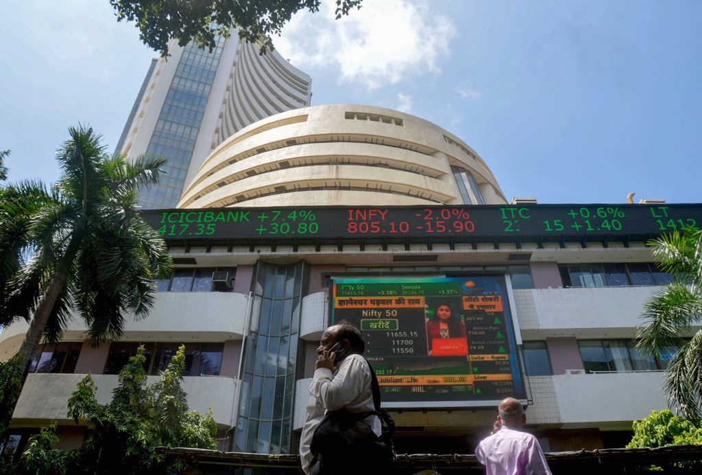 Mumbai: A screen at the facade of the Bombay Stock Exchange (BSE) building shows the stock prices, in Mumbai, Monday, Sept 23, 2019. BSE Sensex on Monday soared over 1,300 points to reclaim the 39,000 mark. (PTI Photo) (PTI9_23_2019_000145B)