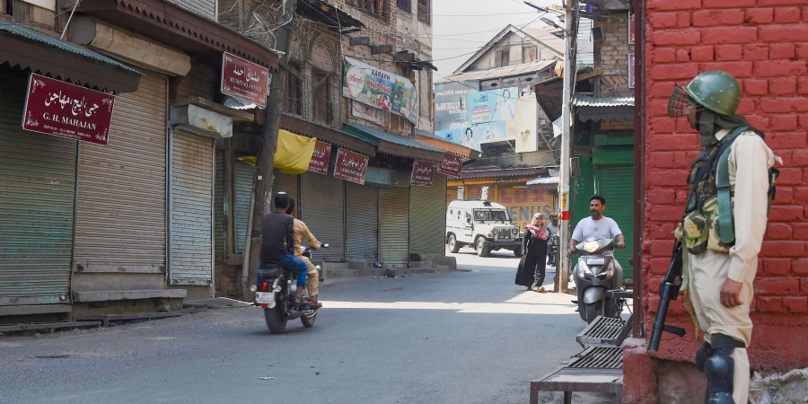 A security personnel stands guard during restrictions in Downtown Srinagar Friday September 13 2019.   PTI