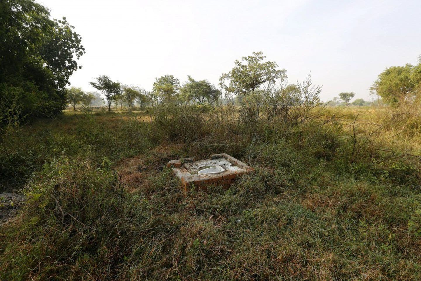 An open toilet sits in a field in Gorba in the eastern state of Chhattisgarh, India, on Nov. 16, 2015. (Adnan Abidi/Reuters)