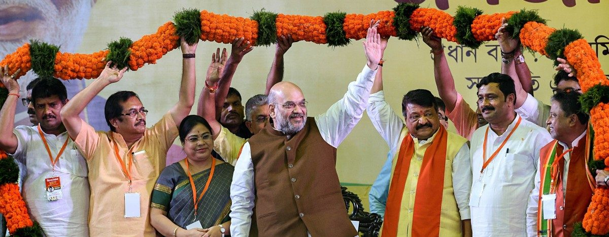 Home minister Amit Shah being garlanded at a rally in Kolkata on October 1, 2019. Photo PTI