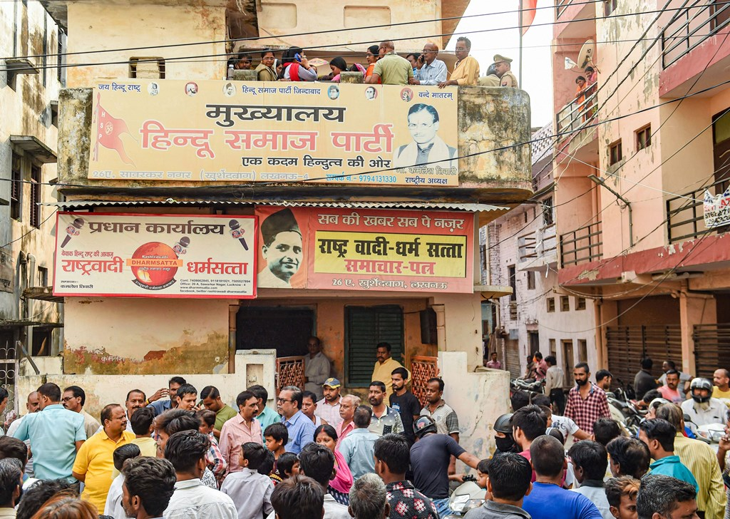 Lucknow: People gather near the office-cum-residence of Hindu Samaj Party founder Kamlesh Tewari afterhe was allegedly stabbed to death by some unidentified miscreants, in Lucknow, Friday, Oct. 18, 2019. (PTI Photo/Nand Kumar) (PTI10_18_2019_000127B)