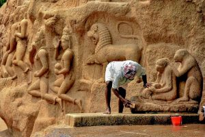 Mamallapuram: A worker cleans monuments at the world famous Mamallapuram heritage site, ahead of this week's Indo-China summit. Prime Minister Narendra Modi and Chinese President Xi Jinping are set to visit the over 1,000-year-old Pallava era monuments during the summit. (PTI Photo)   (PTI10_9_2019_000074B)