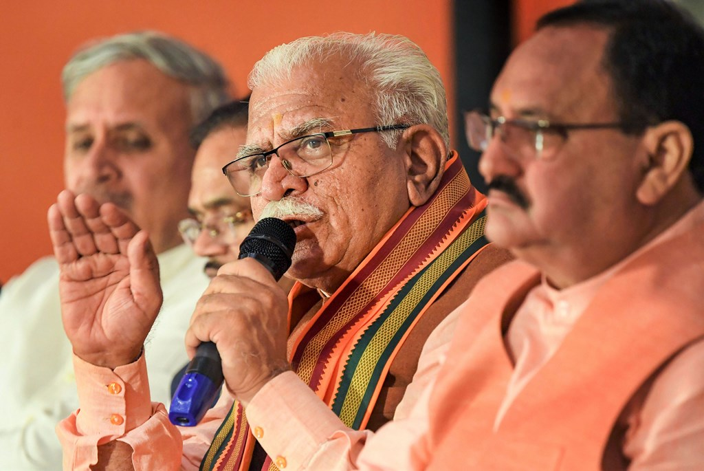 Chandigarh: BJP Working President JP Nadda and Haryana Chief Minister Manohar Lal addresss the media at the release of the party's election manifesto for Assembly polls in Chandigarh, Sunday, Oct. 13, 2019. (PTI Photo) (PTI10_13_2019_000072B)