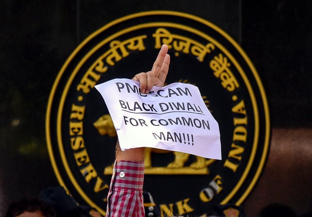 Mumbai: A depositor of Punjab and Maharashtra Cooperative (PMC) bank displays a placard during a protest over the bank's crisis, outside the Reserve Bank of India building, in Mumbai, Tuesday, Oct 1, 2019. (PTI Photo) (PTI10_1_2019_000116B)