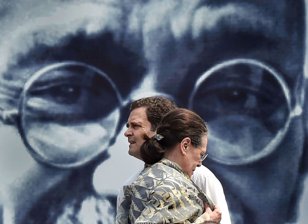 New Delhi: Congress President Sonia Gandhi with party leader Rahul Gandhi at Rajghat to commemorate the 150th birth anniversary of Mahatma Gandhi after party's Gandhi Sandesh 'Pad Yatra' from DPCC to Rajghat, in New Delhi, Wednesday, Oct. 2, 2019. (PTI Photo/Manvender Vashist) (PTI10_2_2019_000262A)(PTI10_2_2019_000319B)