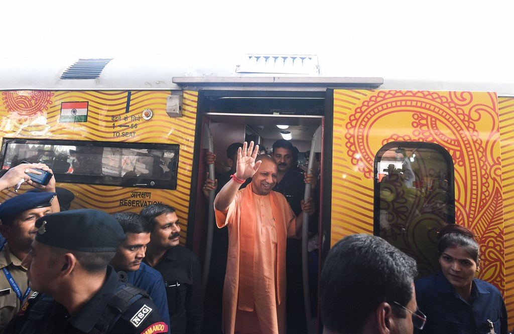 Lucknow: Uttar Pradesh Chief Minister Yogi Adityanath waves after visiting the Lucknow-Delhi Tejas Express, India's first 'private' train by IRCTC (Indian Railway Catering and Tourism Corporation), during its flag-off ceremony at the Charbagh Railway station in Lucknow, Friday, Oct. 4, 2019. (PTI Photo/Nand Kumar) (PTI10_4_2019_000091B)