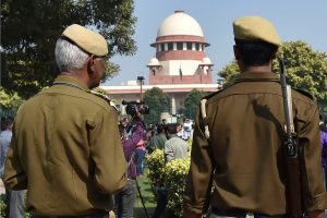 New Delhi: Police personnel stand guard inside the Supreme Court premises ahead of the court's verdict on Ayodhya land case, in New Delhi, Saturday, Nov. 9, 2019. (PTI Photo/Manvender Vashist) (PTI11_9_2019_000222B)