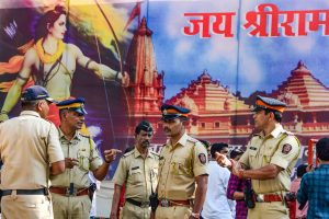 Mumbai: Mumbai Police stand in front of a Lord Ram banner outside BJP headquarters on the day of Ayodhya case verdict, in Mumbai, Saturday, Nov. 9, 2019. The apex court on Saturday cleared the way for the construction of a Ram Temple at the disputed site at Ayodhya, and directed the Centre to allot a 5-acre plot to the Sunni Waqf Board for building a mosque. (PTI Photo)(PTI11_9_2019_000253B)