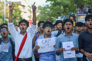Guwahati: Students hold placards as they protest against the Citizenship (Amendment) Bill, in Guwahati, Nov. 29, 2019. (PTI Photo) (PTI11_29_2019_000151B)