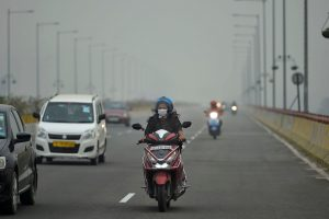 Ghaziabad: A woman wearing a pollution mask rides a scooter, in Ghaziabad, Wednesday, Oct. 30, 2019. The skies over Delhi NCR continue to be smoky grey on Wednesday morning with the air quality hovering between the 'very poor' and 'severe' category and the overall air quality index (AQI) crossing the 400 marks. (PTI Photo/Arun Sharma)(PTI10_30_2019_000033B)