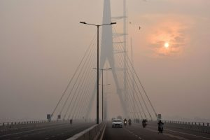 New Delhi: The sun is vaguely seen behind the Signature Bridge amid heavy smog, in New Delhi, Friday, Nov. 15, 2019. A thick layer of toxic smog engulfed Delhi as the pollution level continued to remain in the 'severe' category for the fourth consecutive day. (PTI Photo)